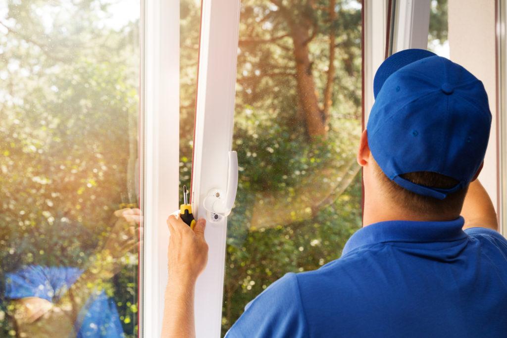 Nex-Gen team member performing window replacement in Fort Collins.